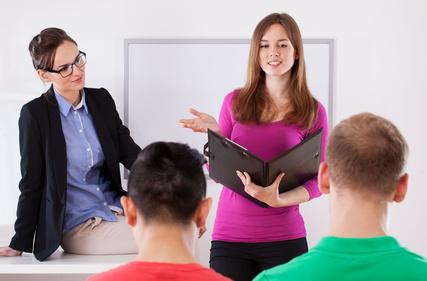 Teacher listening to students