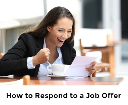 Businesswoman at desk celebrating receiving a job offer with words