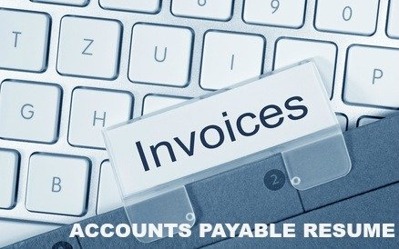 File with tab reading INVOICES and part of a computer keyboard
