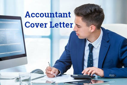 Accountant at desk with calculator and computer