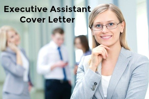 Executive assistant standing in front of colleagues in the office
