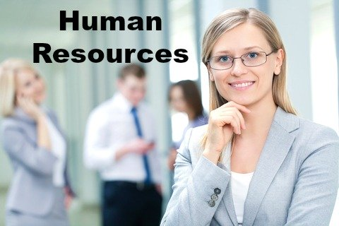 Female HR worker pictured in front of staff members
