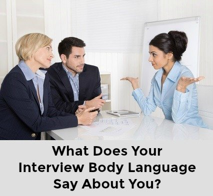 Young woman being interviewed making gesture with hands and words