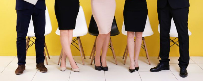 Candidates waiting for an interview in a line, indicating correct shoes for interview outfits