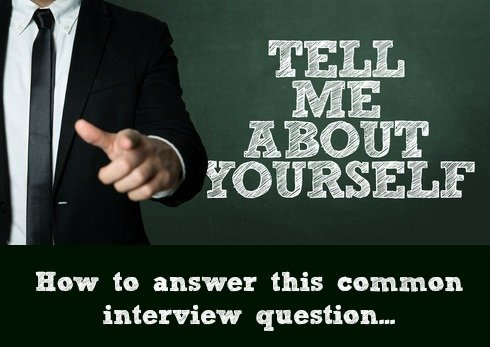 Businessman pointing with words Tell Me About Yourself.