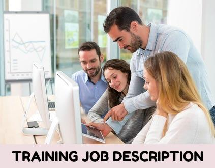 Training Coordinator training employees on computers